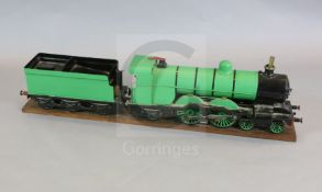 A 3.5 inch gauge 4-4-2 live steam locomotive and tender on wood stand, loco 27in. tender 18in.