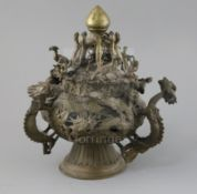A Tibetan bronze hanging censer, 19th century, modelled and pierced with dragons and phoenixes and