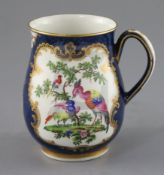 A good Worcester scale blue mug, c.1768-70, of bell shape, painted with exotic birds and butterflies