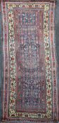 A Bidjar runner, with field of geometric motifs, on a blue ground with multi row border, 10ft 4in by