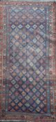 An antique Bidjar carpet, with field of foliate motifs, on a blue ground, 11ft 4in by 5ft 4in