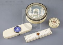 An early 19th century French ivory circular box, two late Georgian ivory toothpick cases and an