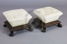 A pair of William IV mahogany footstools, with cushion shaped buttoned pads over a gadrooned