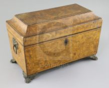 A Regency penwork sarcophagus tea caddy, decorated with exotic flowers, the interior with two