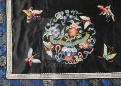 A Chinese embroidered black satin table frontal, late Qing dynasty, decorated with floral