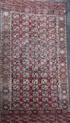 An antique Tekke Bokhara carpet, with field of polygons, on a red ground, with multi row border,