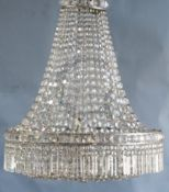 An early to mid 20th century cut glass bag chandelier, hung with spear, square and octagonal cut