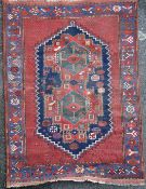 An Afshar rug, with central stepped motif, on a red ground, with three row border, 5ft 8in by 4ft