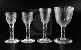 Four facet-stemmed drinking glasses, late 18th century, the pair of cordial/wine glasses engraved