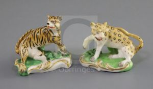 A pair of Derby porcelain figures of a tiger and a leopard, c. 1820-30, each in menacing pose on a