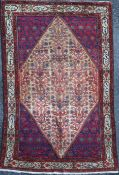 A Malayer rug, with filled of foliate motifs, on a red/blue ground, 6ft 6in by 4ft 6in.