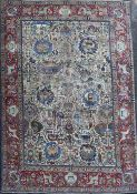 A Tabriz picture carpet, with field of figures, animals, vases, birds etc. on an ivory ground,