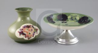 A Moorcroft sage green ground 'pomegranate' vase and a similar 'pansy' dish, c.1918, the vase of