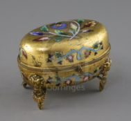 A 19th century Russian enamelled ormolu casket, of oval form, decorated with flowers, standing on