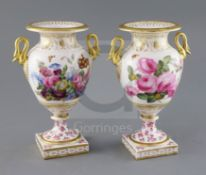 A pair of English porcelain vases, c.1820, the ovoid bodies applied with a pair of gilt swan neck