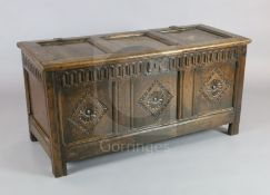 A 17th century oak coffer, with triple panelled top and front, W.4ft 2in. D.1ft 9in. H.2ft 1in.