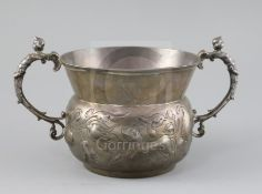 A A large 19th century 17th century style two handled silver porringer,
