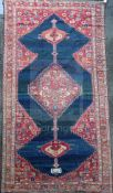 An antique Karabagh carpet, dated 1892, with stepped motifs on a red ground, with three row