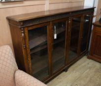 A 1920's glazed oak four door bookcase W.183cm