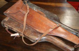 Three vintage leather gun cases
