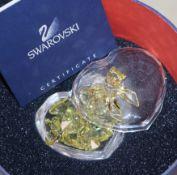 Ten various pieces of boxed Swarovski crystal