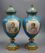 A pair of Sevres style 'Napoleon & Josephine' bleu celeste vases and covers, late 19th century