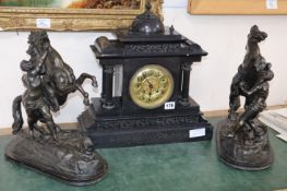 A Victorian black slate mantel clock and a pair of spelter Marly horses