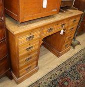 A late Victorian oak kneehole desk W.120cm