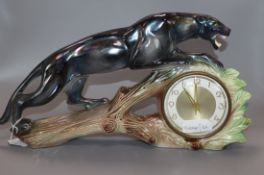 A French ceramic panther mantel timepiece height 23cm