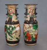 A pair of Chinese crackle glaze 'warrior' vases, Guangxu period (1875-1908) height 25cm