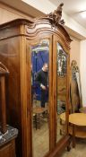 An early 20th century French walnut mirrored armoire H.256cm