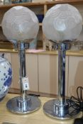 A pair of chrome/frosted glass lamps height 59cm