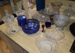 A collection of cut glass lidded dishes, a celery vase and overlaid bowl, etc.