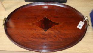 An Edwardian oval mahogany tray width 66cm