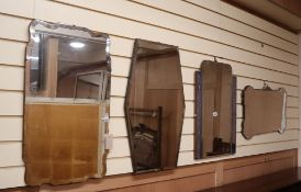 Four 1930's wall mirrors largest W.69cm