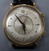 A gentleman's 18ct yellow metal Jaeger LeCoultre memovox alarm manual wind wrist watch, one