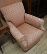 A Victorian-style upholstered armchair