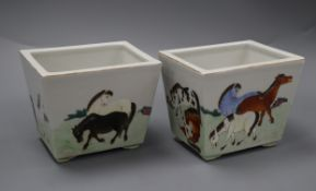 A pair of square porcelain pots decorated with horses