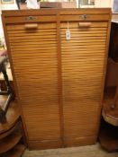 A mid century French double tambour filing cabinet H.150cm