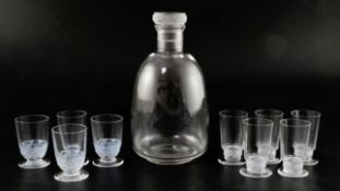 A Rene Lalique Dampierre pattern carafe and six glasses with moulded bands of birds and three