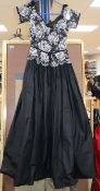 A black 1950's lace and pleated silk evening dress