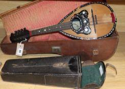 A Pietro Tonelli Napoli mandolin and an ebony and nickel-mounted clarinet
