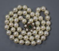 A single string of uniform cultured pearls with 14ct gold, pearl and emerald-set clasp, 48cm.