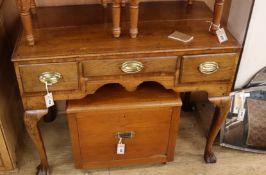 A George III oak side table W.96cm