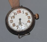 A gentleman's early 20th century white metal cased manual wind wrist watch, with Arabic dial and