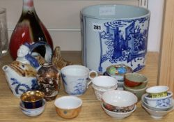 A quantity of Chinese and other porcelain including tea bowls, a bottle vase and a large blue and