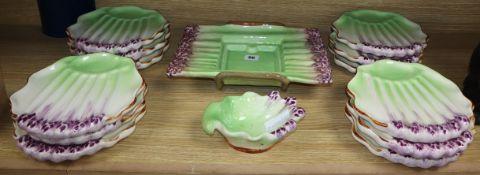 A French glazed pottery fourteen piece asparagus serving set