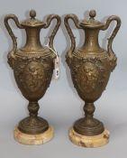 A pair of gilt spelter urns