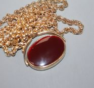 A 9ct yellow gold-mounted oval swivel fob seal set bloodstone and carnelian matrices, on 9ct gold