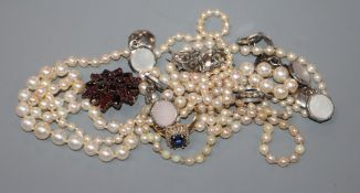 Three assorted cultured pearl necklaces, a Victorian yellow metal and garnet brooch, a 9ct ring